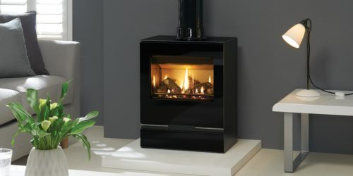 A gas stove on a white hearth